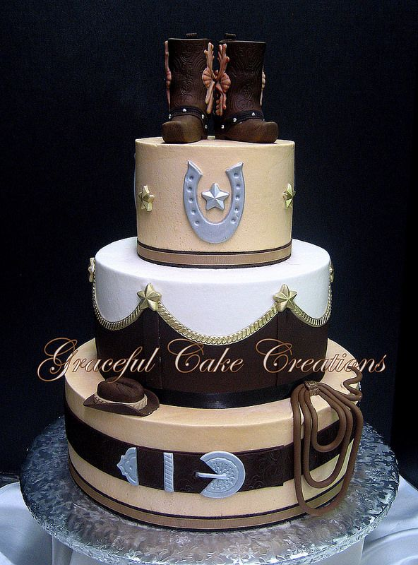 Elegant Western Themed Wedding Cake with a pair of Cowboy Boots as the cake topper.