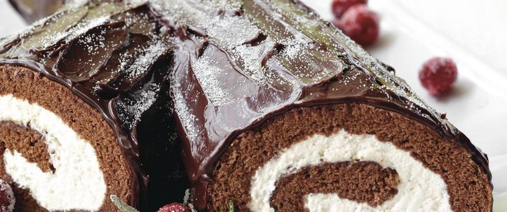 Create a traditional French Christmas cake shaped and decorated to look like a yule log.