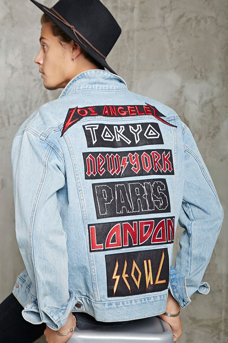 """A denim jacket with heavy metal-inspired back patches featuring """"Los Angeles"""", """"Tokyo"""", """"New York"""", """"Paris"""", """"London"""", and """"Seoul"""", as well as a buttoned front closure, buttoned flap chest pockets, slanted welt front pockets, a basic collar, a front """"1989"""" patch, and button-cuff long sleeves."""