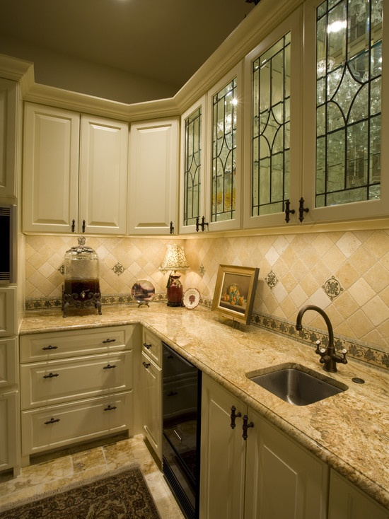 Leaded glass windows front a lighted glass cabinet for stemware...