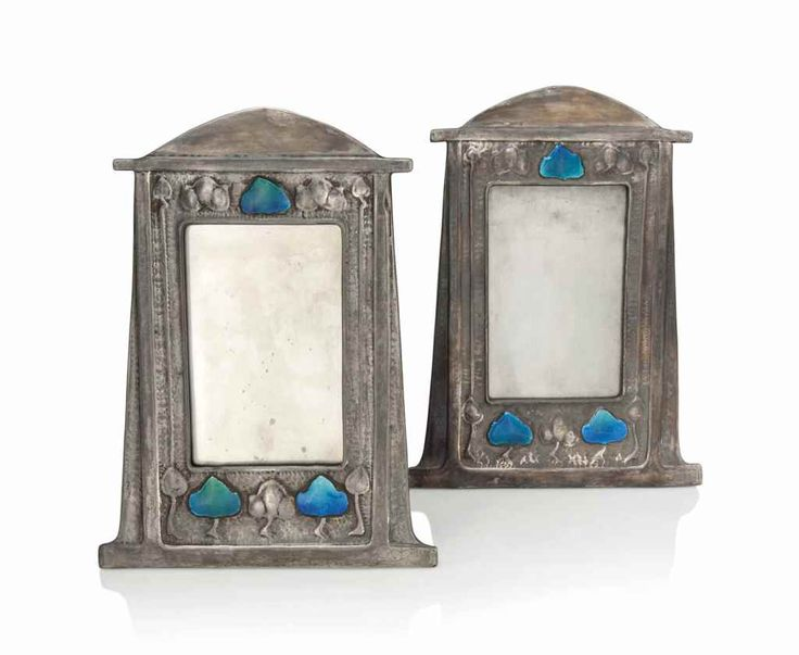 A MATCHED PAIR OF ARTS & CRAFTS PEWTER AND ENAMEL PHOTOGRAPH FRAMES ATTRIBUTED TO LIBERTY & CO CIRCA 1900, STAMPED 0392 Estimate GBP 2,500 - GBP 3,500