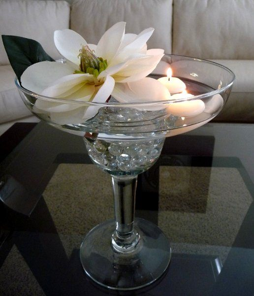 Margharita Centerpiece with floating candles and a White Magnolia ....simple but elegant. Good for a wedding or a corporate event. Rent this in the Savannah area.