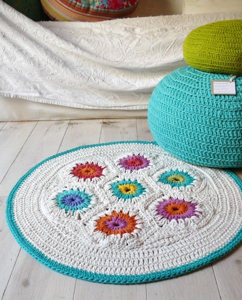 DIY idea -- would like to try this rug in more boyish colors for J's room. Need to hone my crochet skills, though!