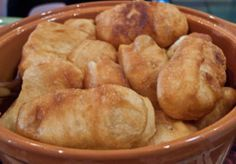 Vetkoek (pronounced FET-cook and sometimes known as 'fat cook') is a traditional Afrikaner pastry. It is dough deep-fried in cooking oil and either filled with cooked mince (ground beef) or spread with syrup, honey, or jam. It is thought to have its origins from the Dutch oliebollen, which go back to the time of the migration period. It is similar in taste to Mexican sopapillas.