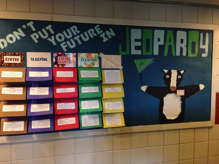 My Jeopardy themed bulletin board. I added a big badger on for school spirit because it's our school's mascot. Each colored rectangle has a question on the outside and and an answer under the flap. This board went over well because it got residents to stop and interact. Would do again no matter how much time it took. #Jeopardy #Bulletin #Board #RA #College #Badger