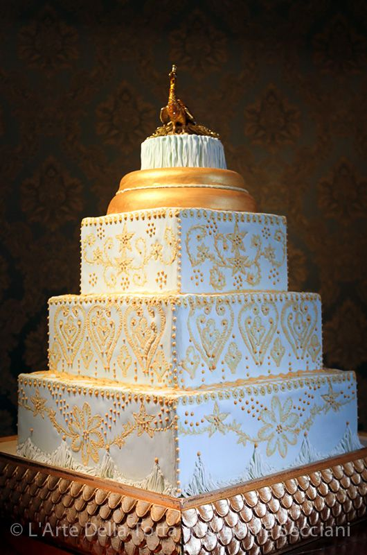 Tuscany Wedding cake by L'Arte Della Torta di Melanie Secciani in Florence, Italy.  Absolute glamor and fun. This four tier wedding cake, mimics a gold and mint green 1920′s wedding dress. The pattern from the dress was hand piped in sugar on each of the tiers, and the fringe from the dress was recreated in sugar for an exclusive event in Florence, Italy.
