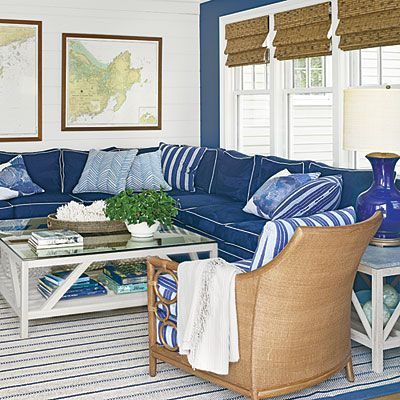 New classic nautical family room with navy ultrasuede Clarence House sectional (featured on Coastal Living)