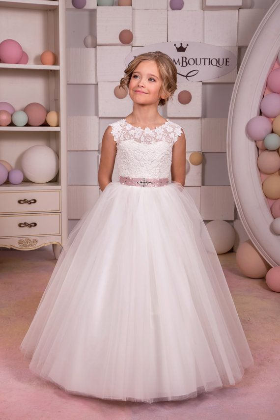 Please read our store policies before placing your order here https://www.etsy.com/ru/shop/Butterflydressua/policy  Beautiful ivory flower girl dress with multilayered skirt, corset with lace applique, buttons, zipper and lacing, and satin stripe with rhinestones. Item material: upper layer of the skirt- tulle  middle layer of the skirt- tulle  lower layer of the skirt- taffeta  corset- satin, lace  Dress color: ivory  white  Color of the sash: ivory  blush pink  red  ice blue  royal blue…