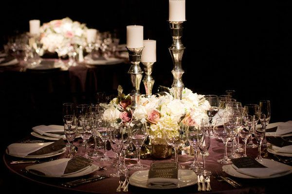 I love the staggering of candles mixed in with the floral arrangement of the color pallet equaling an A + for the wedding centerpieces