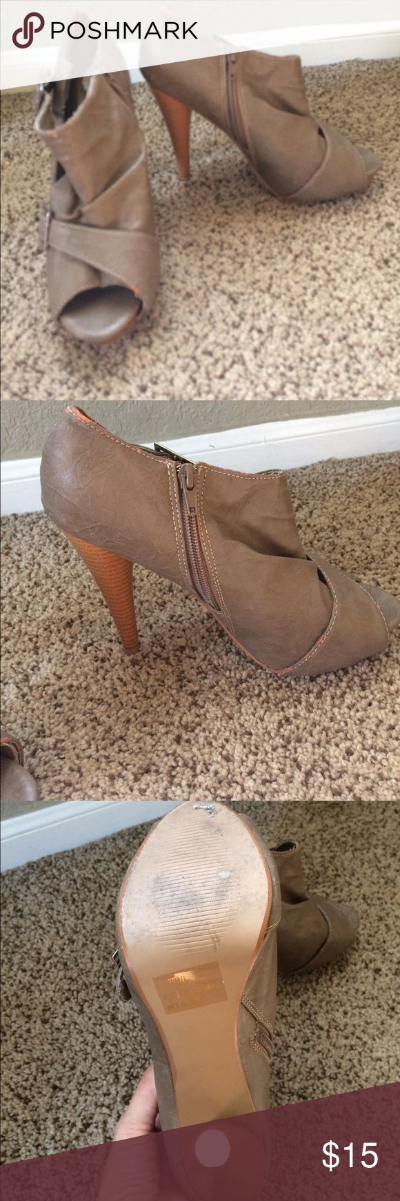 Taupe Charlotte Russe booties Taupe Charlotte Russe booties with zipper on the side and a buckle for embellishments. Couple places of wear (in pics) Charlotte Russe Shoes Ankle Boots & Booties