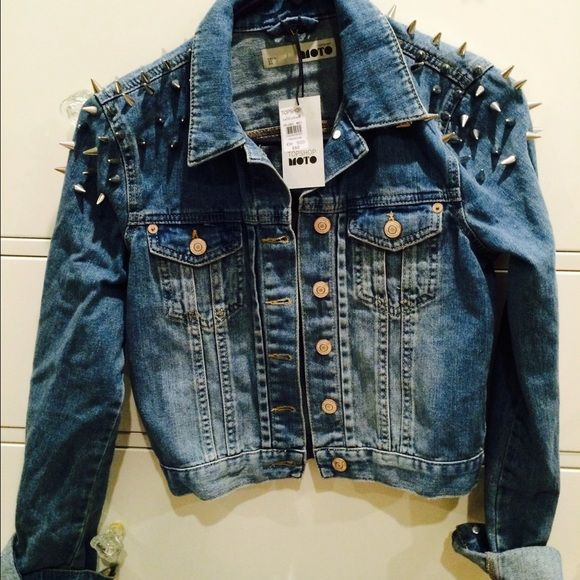Topshop denim jacket with studs Super cute fitted denim jacket with studs on the shoulder. It can be worn to edge up any outfit! Topshop Jackets & Coats Jean Jackets