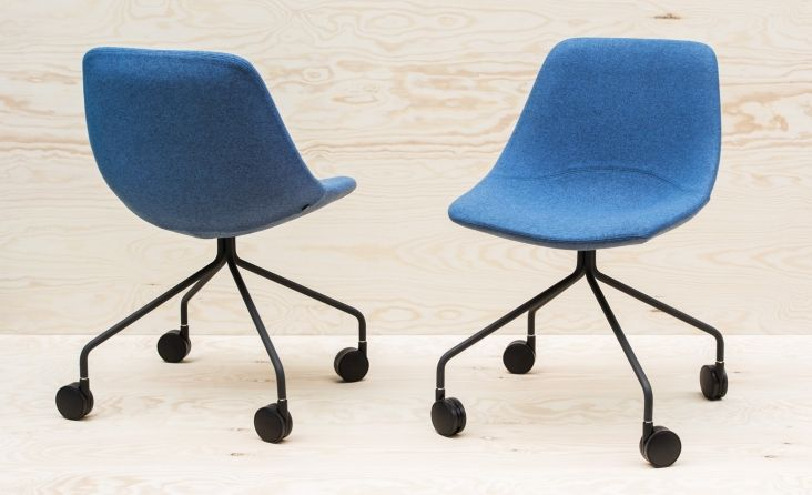 One of many Mishell chairs designed by Noti and covered in Wool fabric from Dekoma