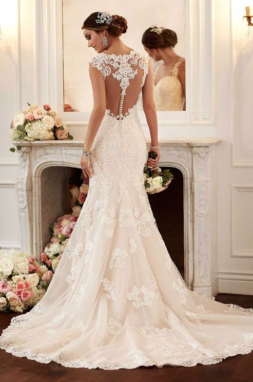 This Stella York lace wedding dress features gorgeous illusion back detail.