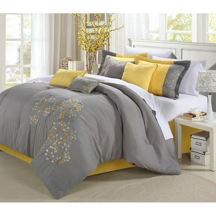 This floral 8-piece gray and yellow comforter is simple yet elegant with its embroidery touches. This set includes a comforter, bedskirt, two shams and four decorative pillows that will bring a charming look into your bedroom.