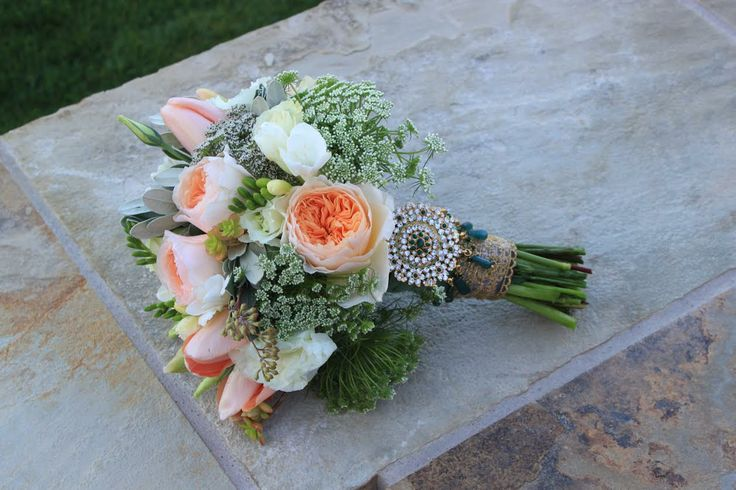 Vintage with Juliet roses and Queen Annes Lace. Bridal bouquet we made for our bride last month.