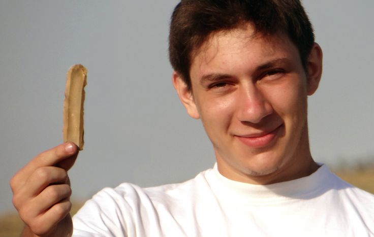 Day 12: Cristi with a whole flint blade. It was found on the surface of a nearby field that had recently been ploughed.