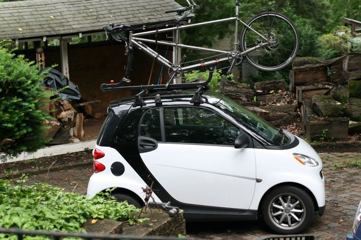 Smart Car with Tandem bike and roof rack loaded on top