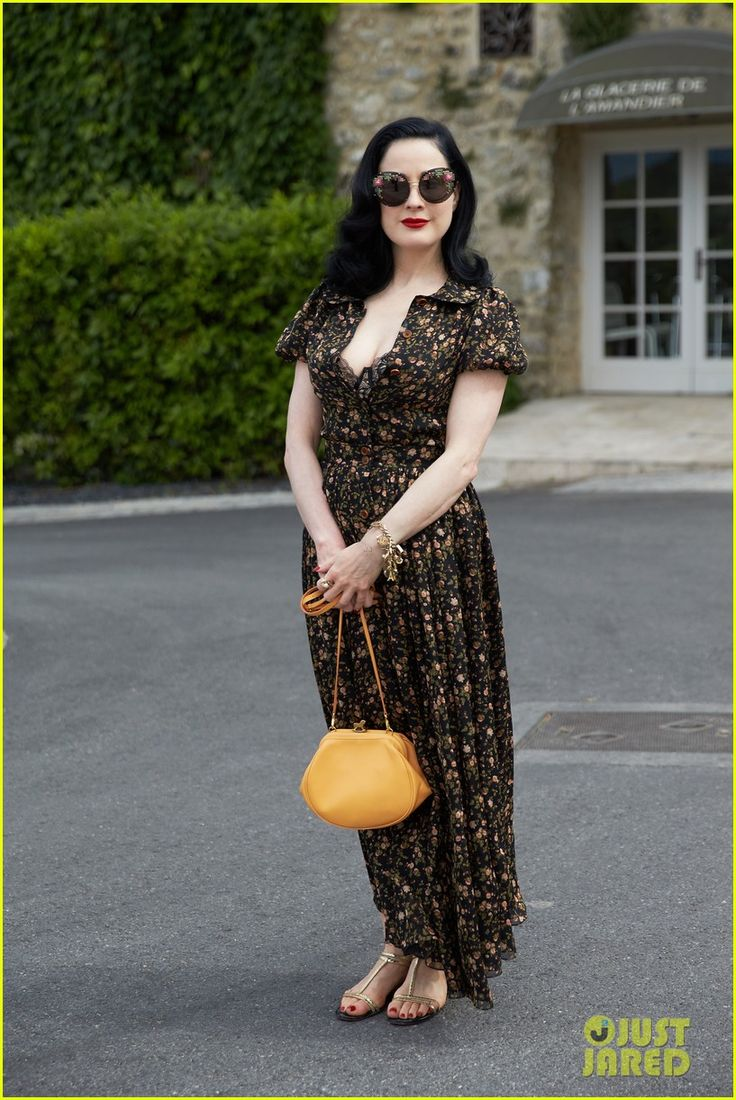 Dita Von Teese in an Ulyana Sergeenko dress, bag and sunglasses with Christian Louboutin sandals.