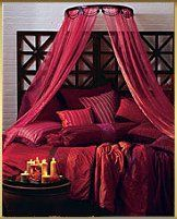 Red Moroccan bed - Oooo lah lah! The best of everything: red...sheer netting...scads of pillows...candles. Love Den indeed.