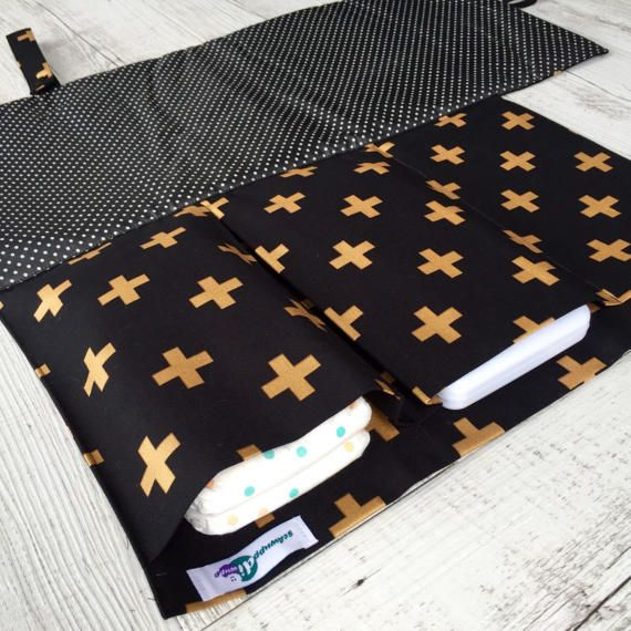 This beautifully designed nappy change set // nappy wallet // nappy clutch // travel change mat features a built-in change mat and has 3 practical pockets to fit 2-3 nappies, travel baby wipes (hard case or soft pack), disposable nappy bags, mini nappy rash cream etc. One pocket closes with a velcro, the other 2 are open for easier access. You can access the wet wipes without having to open up the nappy wallet which is handy once bub starts solids or is messy in ...