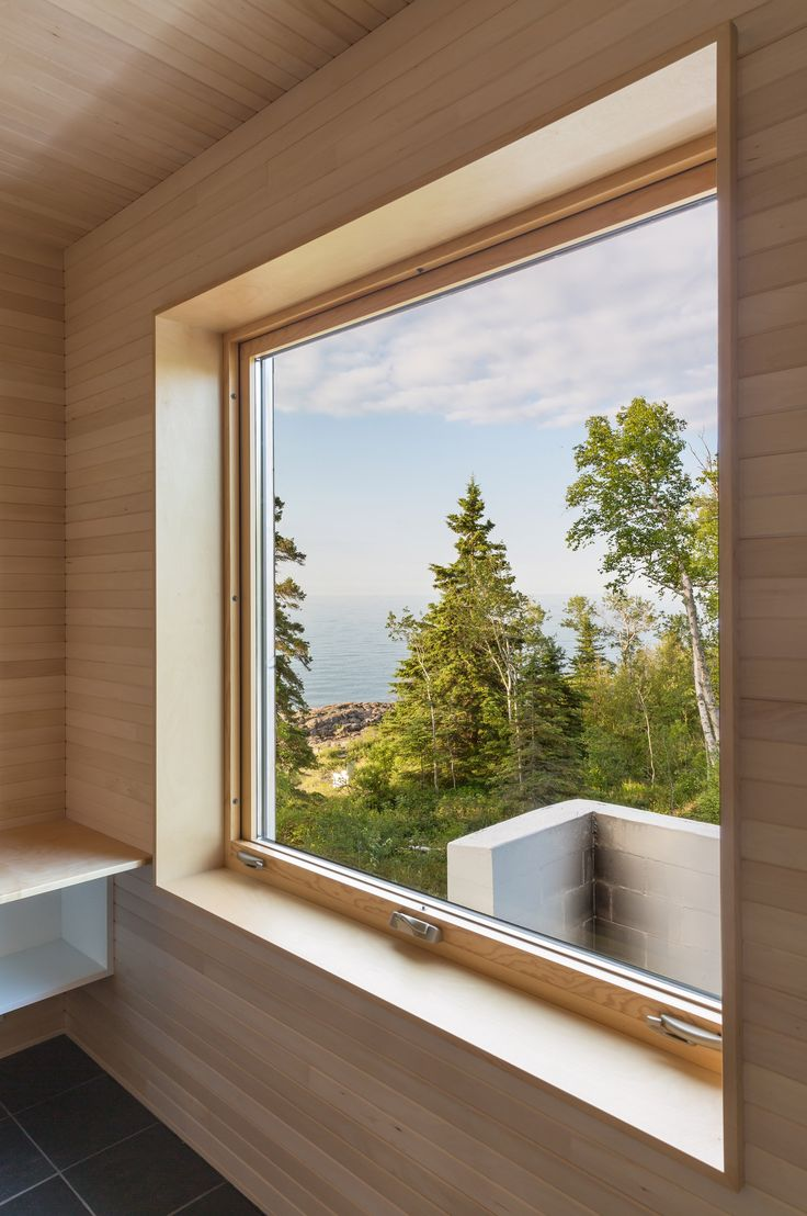 Minnesota firm Salmela Architect has completed a cabin with a courtyard framed by a whitewashed sauna adjacent to the main house.