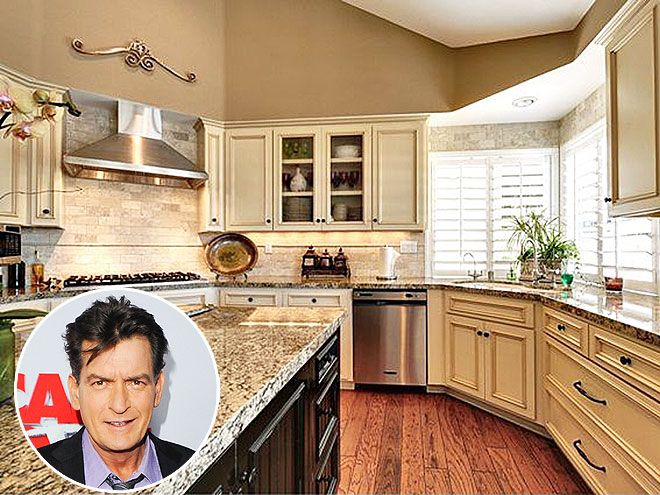 Look Inside These Gorgeous Celebrity Kitchens | CHARLIE SHEEN | Just a little over a year after purchasing his L.A. home for $1.6 million, the actor listed the four-bedroom, four-bath property for almost $1.7 million. The house features an infinity pool, picturesque views and a custom granite kitchen with a muted color palette.