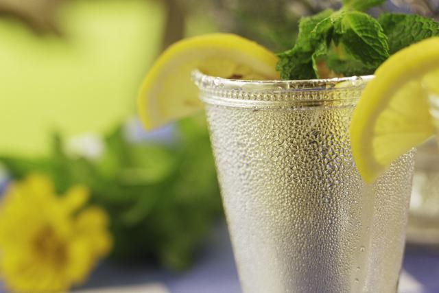 Cocktail recipe for a Mint Julep, a popular mixed drink made simply of mint and bourbon whiskey that is the official drink of the Kentucky Derby.