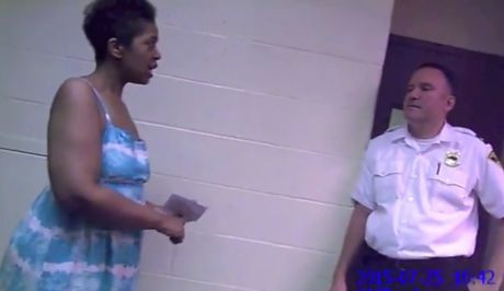 Ralkina Jones, left, is shown in body camera footage telling a Cleveland Heights officer that she is worried about her health. (Cleveland Heights Police Department)