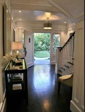 Dark wood flooring and stairs are so elegant and sleek!! I love them