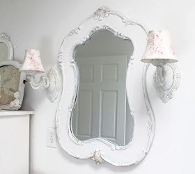 shabby story-flea market sconces and hobby lobby mirror in guest bath