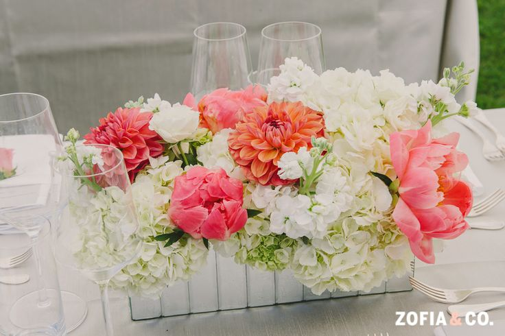 White and coral on gray tablecloth but with blue mason