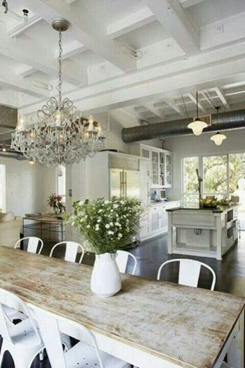 Farmhouse kitchen/dining combo, love it and the huge open feeling from the window. I want a patio/outdoor space right off the kitchen like this