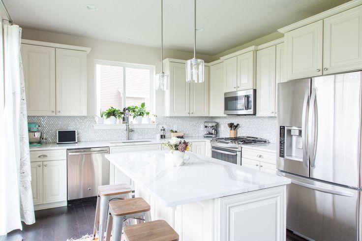 """Athena's countertops are from a Minnesota company, Cambria. They're called Brittanicca. """"Although adding Cambria to our kitchen was a splurge, supporting a local business with a high-quality American-made product was a no-brainer. These natural quartz countertops will stay this beautiful forever and are hands down my favorite investment."""""""