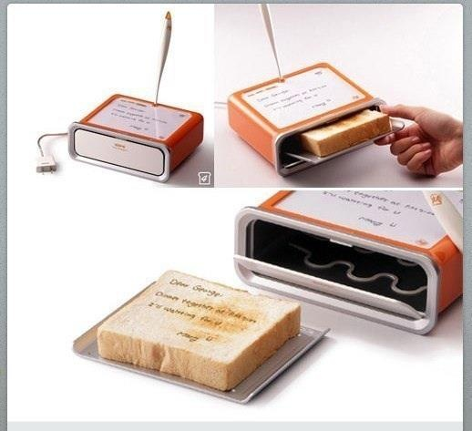 etch-a-sketch style, the magnetic dust will rise up, leaving an open space in the pile of magnetic dust. Apply heat above pile of dust, the space where the dust has been lifted will transfer heat to the bread faster, burning the words into the bread.