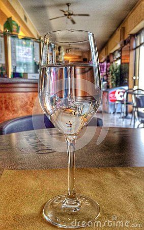 Water glass on the table - new @dreamstime