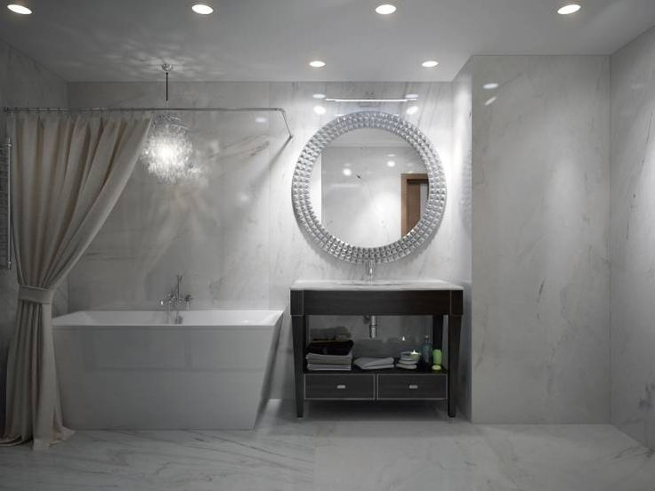 This white bathroom is a classic one with drapes pulled to a side of the asymmetrical vintage-style bathtub.  Bathroom by design studio by Mariya Rubleva
