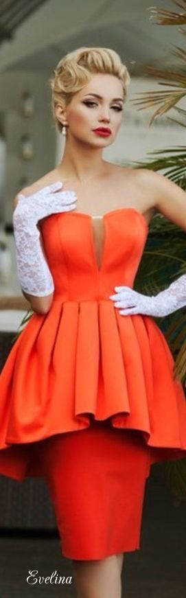 A beautiful bright orange, or you can state coral dress with the peplum styled top, and straight pencil styled skirt to match.