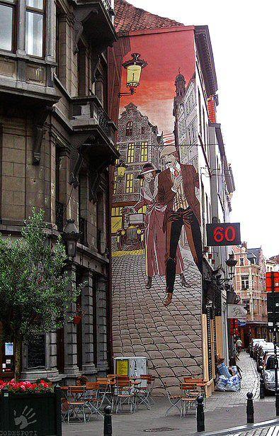 """- rue du Marché au Charbon-La fresque de Victor Sackville d'après un projet original de Francis Carin fut inaugurée en mai 1992. Sa superficie est d'environ 35 m². Réalisation de G. Oreopoulos et D. Vandegeerde de la société """"Art Mural""""."""