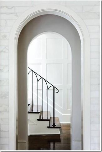 Iron railing done right... and marble...and white painted woodwork... and arches...
