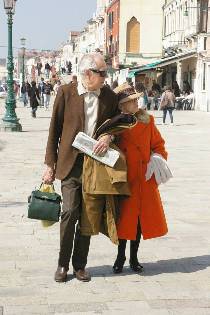 This is true love, how many men would carry a women's purse for her.  Venice, Italy
