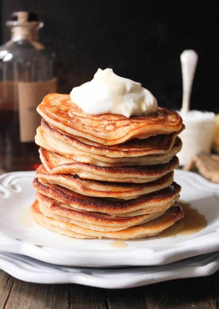Ricotta Pancakes with Maple-Bourbon Whipped Cream. The lightest, fluffiest pancakes in all the land.