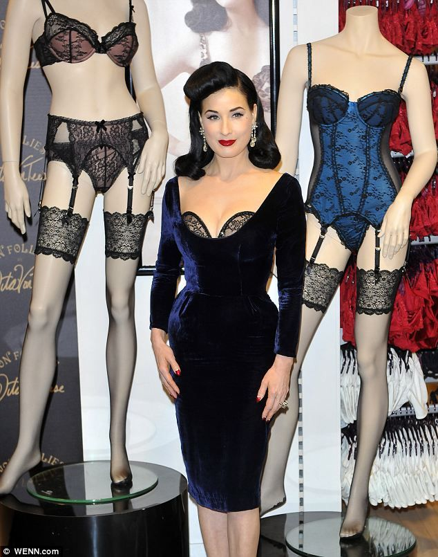 dita von teese unveils new lingerie line for debenhams in what else a plunging dress and. Black Bedroom Furniture Sets. Home Design Ideas