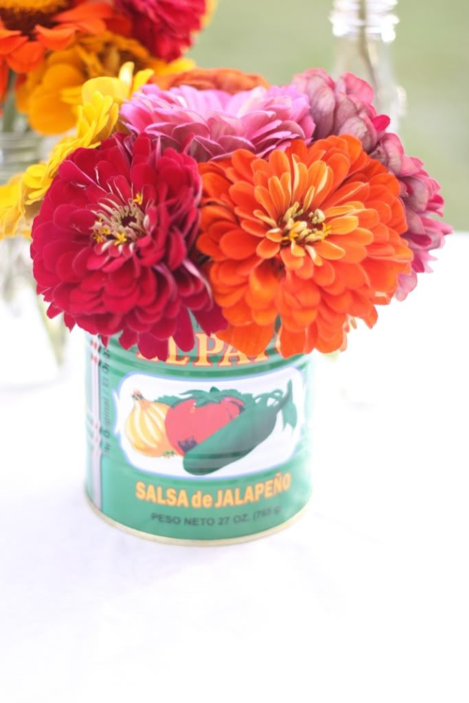 The flower inspiration came from this amazing Mexican Fiesta rehearsal dinner I saw on Style Me Pretty a while back. I purchased three huge bouquets of zinnias from the Minneapolis Farmers Market for a total of $12. I used a couple empty salsa cans as vases along with empty bottles of Mexican soda.
