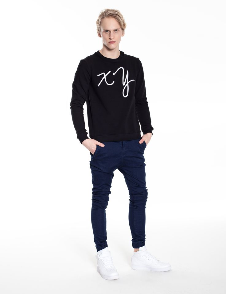 Model is wearing:  XY chromosomes sweatshirt in black & Universum jeans in blue denim