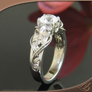 Love the flowers and vines, especially how they wrap beyond the band. #engagement #jewelryworks