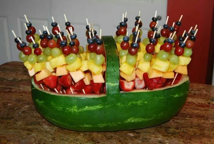 Fruit kabobs in watermelon basket
