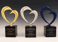 Bennett Awards worked with Hospice Compassus, a nationwide hospice company, to create a set of custom awards for a new recognition program they rolled out. The award design was based on the Hospice Compassus logo. The awards were cast in pewter, and featured a unique finish for each of the three award variations: gold plating, silver plating, and blue plating. The engraving on each award base was also a different color to help further differentiate the awards.