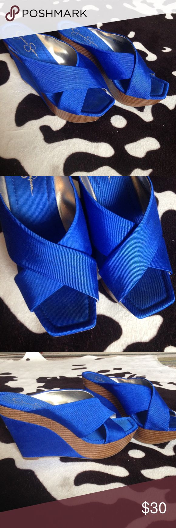 Jessica Simpson Blue Wedges 8.5 Jessica Simpson Wedges in a really pretty Blue. I loved how they looked and felt but they're too big for me.  There's a little dirty spot on the outside straps of the shoes- see pic. Jessica Simpson Shoes Heels