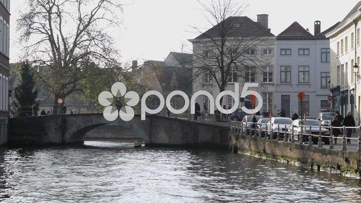 A bridge & houses in Bruges, Belgium. Tourists, cyclists. With sound - Stock Footage | by glenman77