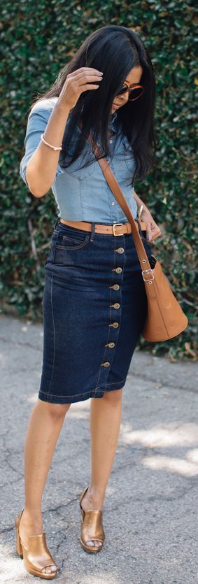 Dark denim jean skirt paired with a chambray top and gold accessories makes for chic denim on denim outfit that is the perfect street style look for turning heads.